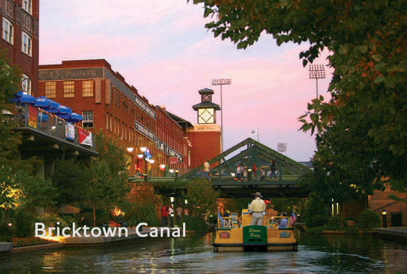 A tour boat floats past restaurants and shops on Oklahoma City's Bricktown Canal.