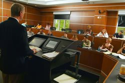 A professor speaks to students.