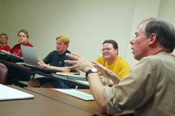 Professor Starkey speaks in a classroom