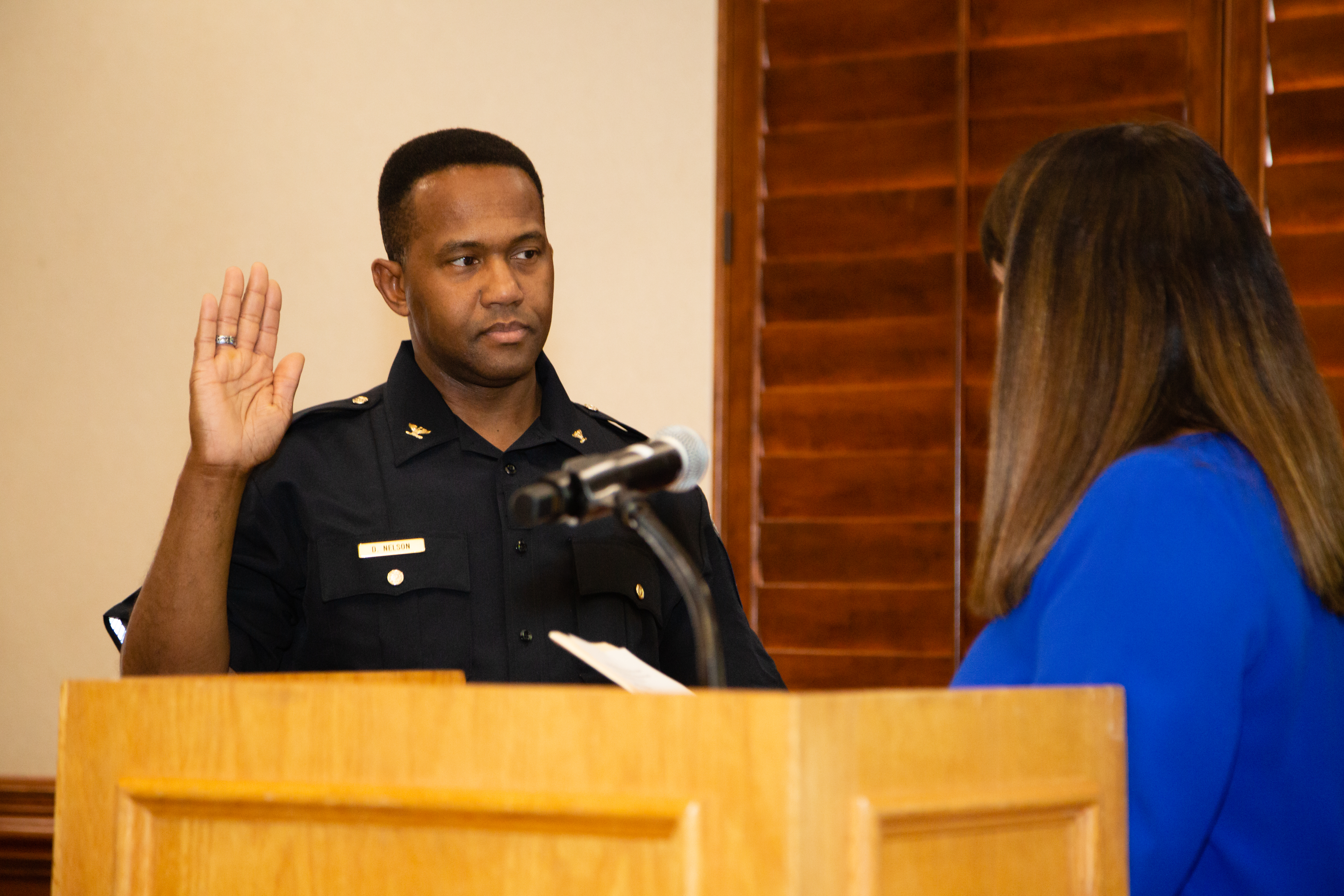 Chief Nelson being sworn in by President Burger.