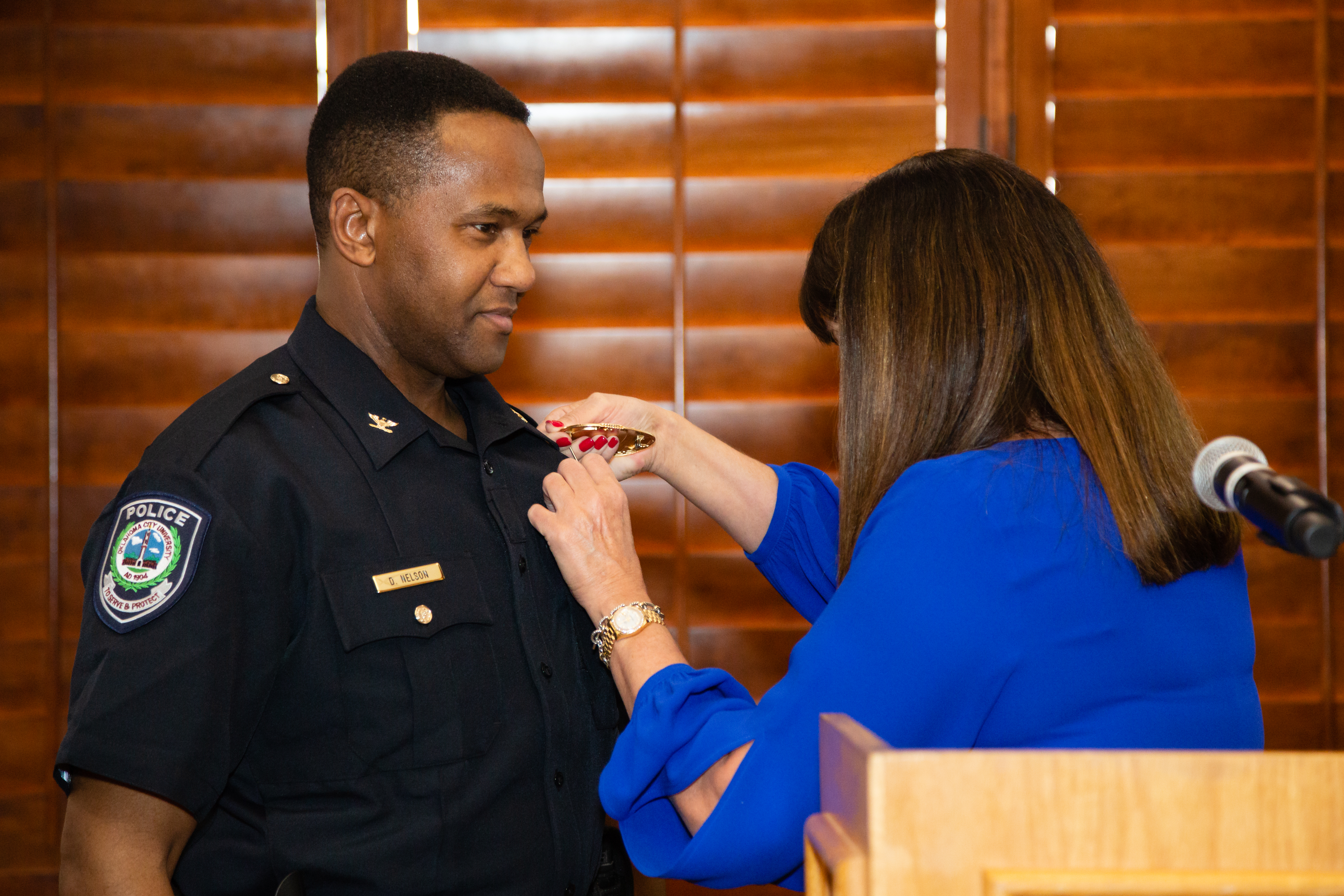 Dexter Nelson being pinned by president Martha Burger.