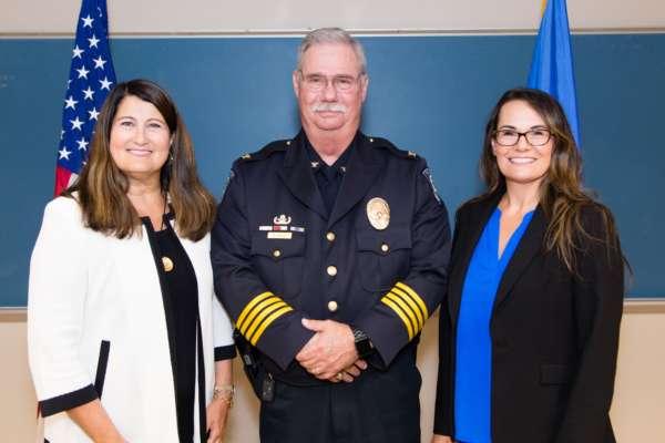 President Martha Burger, Chief Rusty Pyle and Vice President for Human Resources Joey Croslin at Pyle's Pinning Ceremony