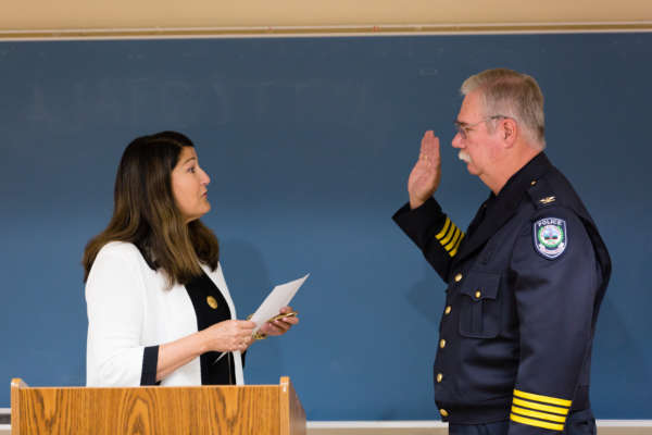 Chief Rusty Pyle is sworn in as new OCU Police Chief by President Martha Burger