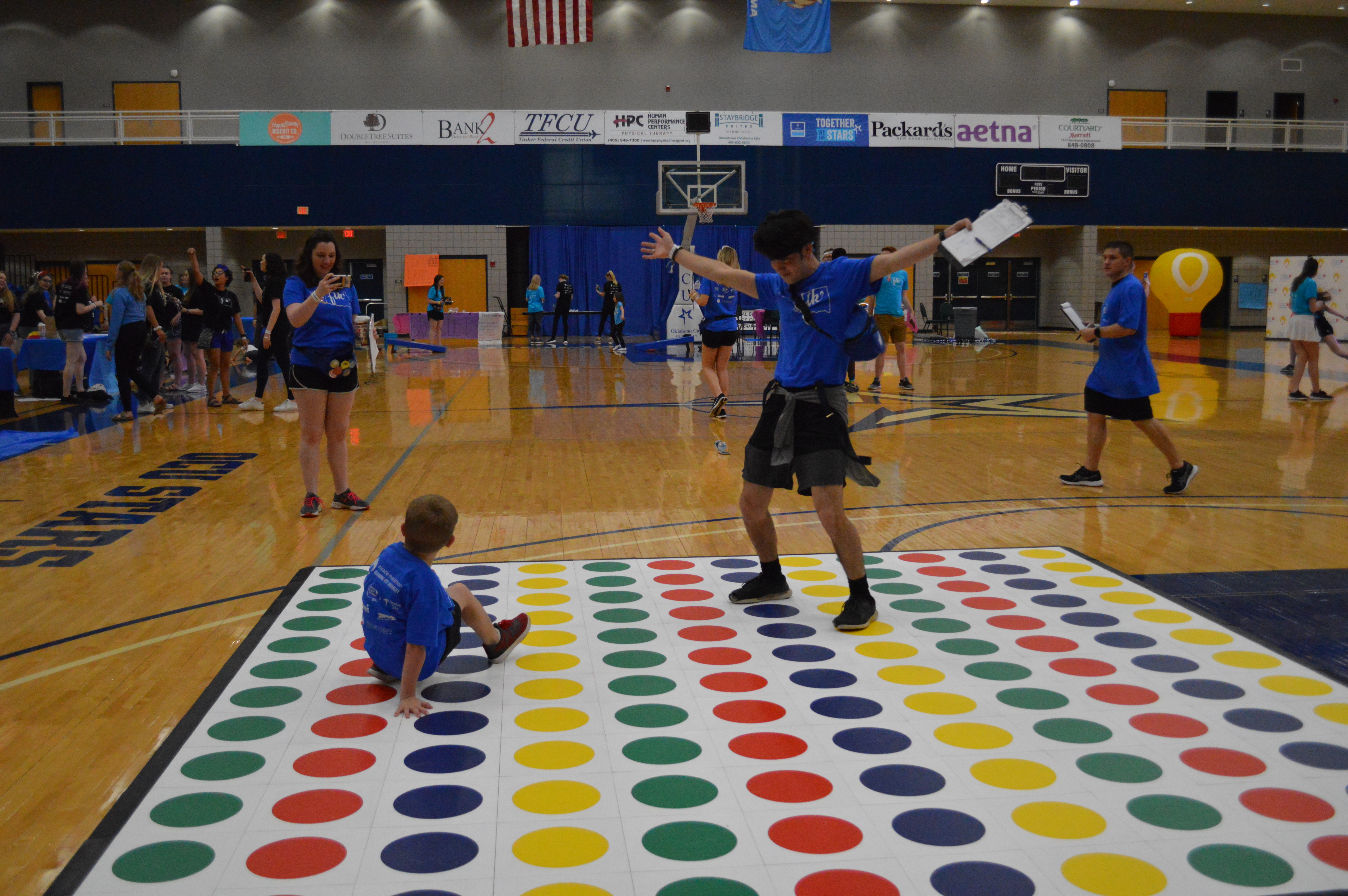 A giant Twister game entertained children and adults at the Miracle Marathon