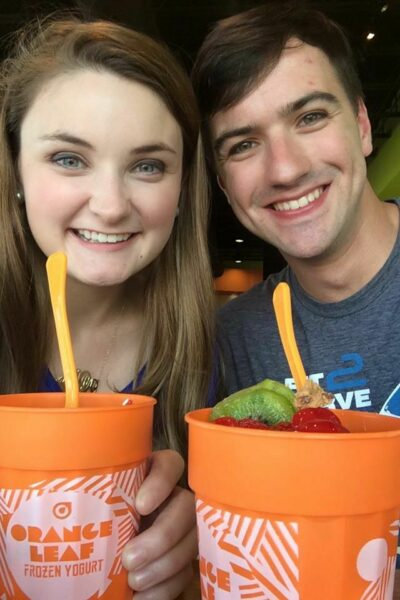Zack Travers and Virginia Newsome-Travers with cups of frozen yogurt from Orange Leaf