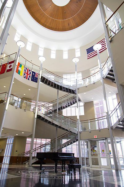 The Meinders School of Business lobby, a three-story atrium with flags of the world displayed.