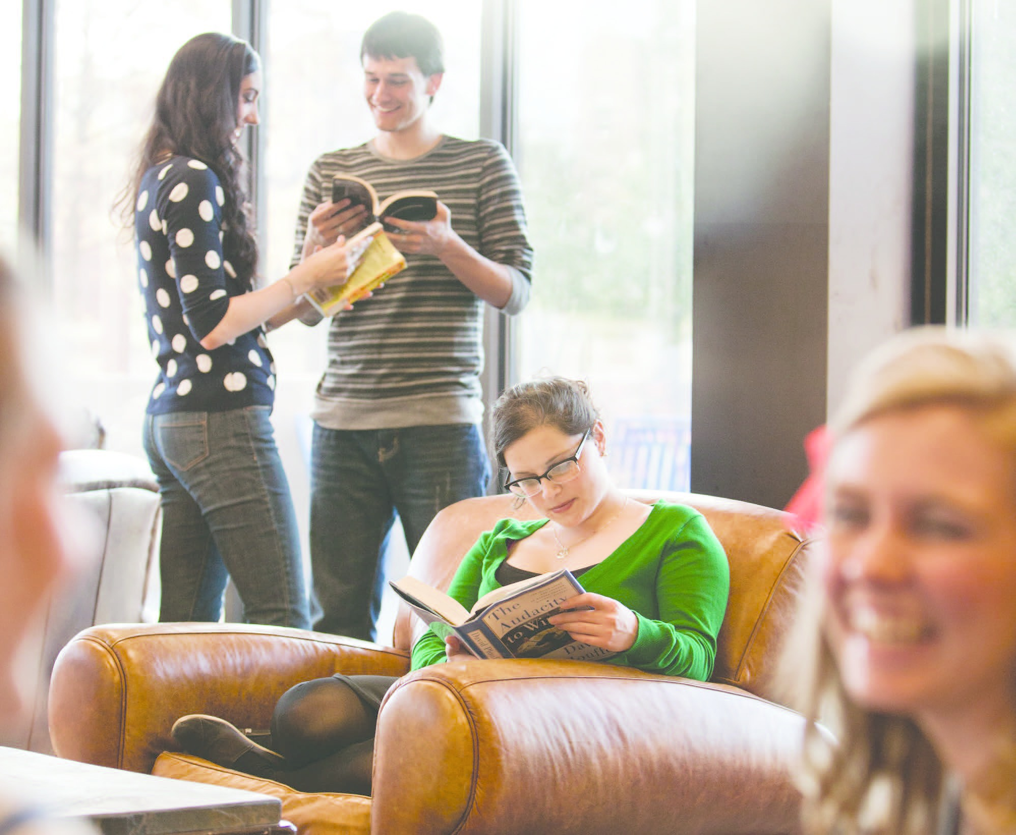 students read and talk in the library lounge