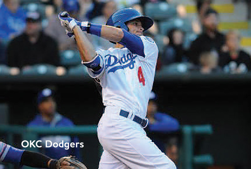 A player for the Oklahoma City Dodgers baseball team swings at a pitch.