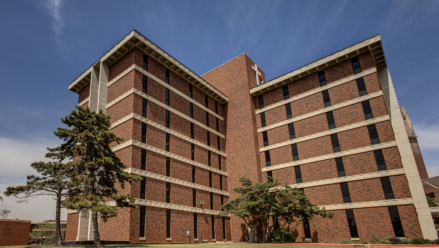 Walker Hall, a seven-story brick freshman dormitory on OKCU's Campus