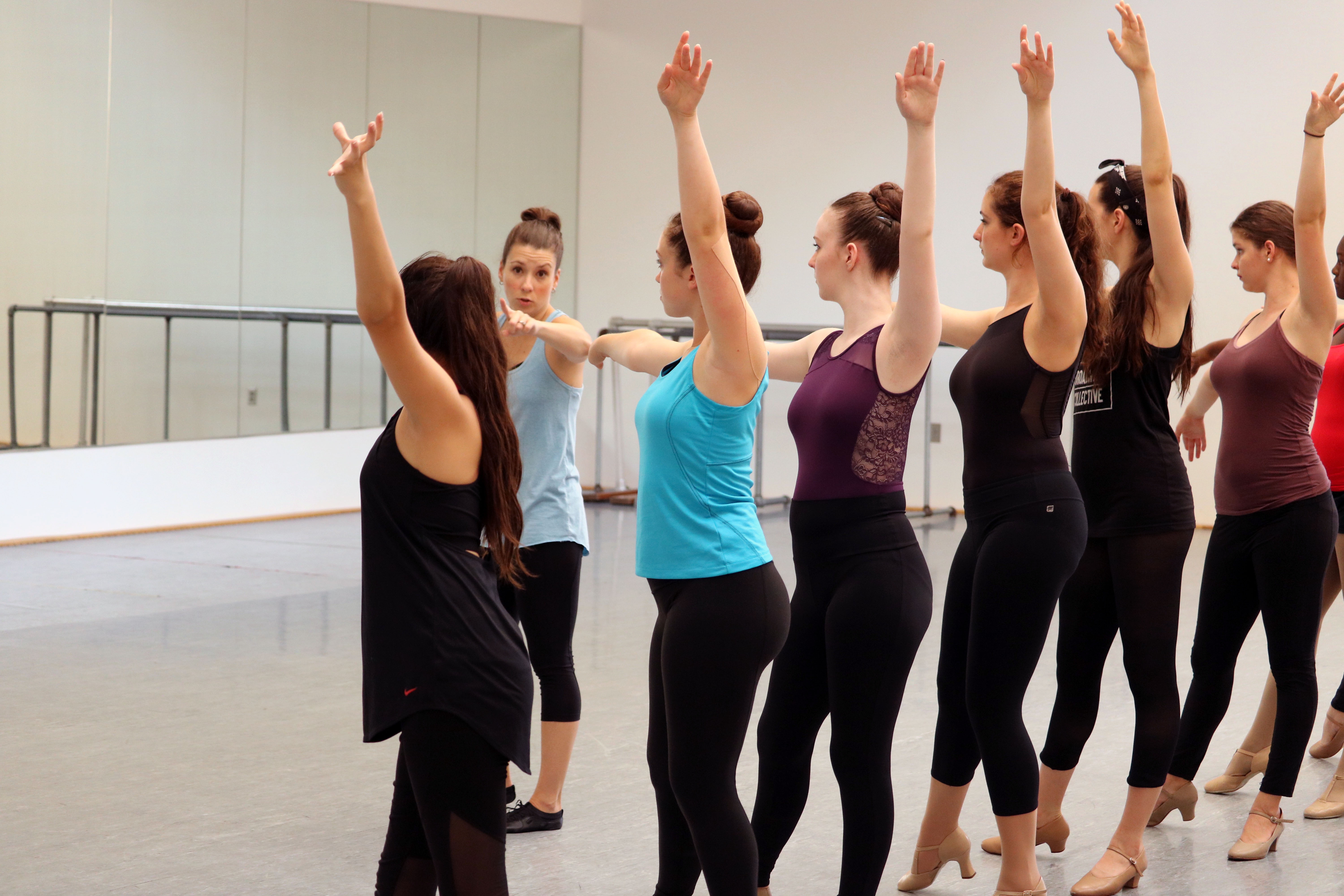 Students stretch during practice at Broadway Bound