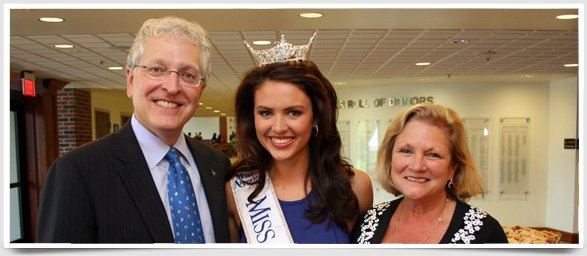 OKCU President Robert Henry poses with one of the university's multiple Miss America contestants.