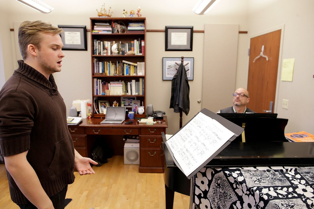 An OKCU music student sings during a one-on-one lesson with a faculty member.