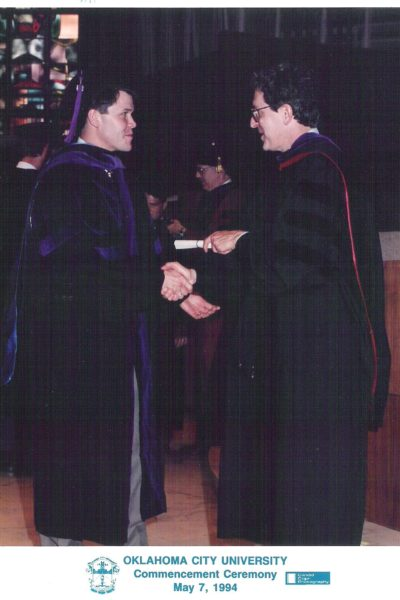 Jim Roth (left) accepts his OCU law degree from then dean Robert Henry in 1994.