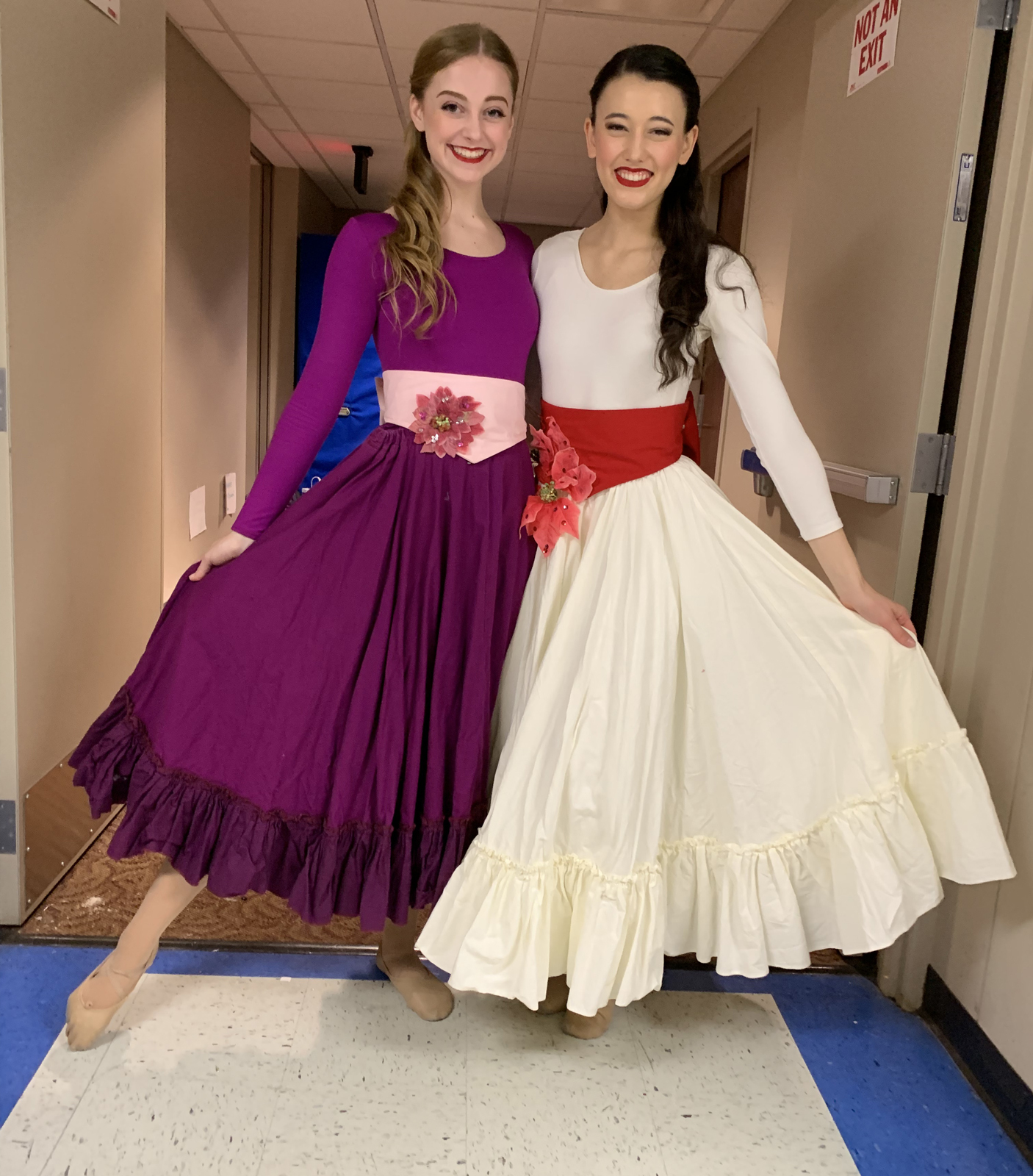 Ashley Ellis and a fellow dancer in swirly dresses