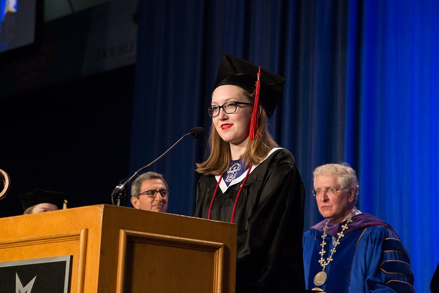 Melaina Riley at podium during commencement