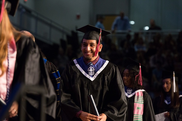 Miguel Rios receiving his diploma at commencement