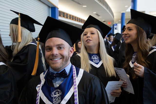 Tucker Walker with other graduates on commencement day