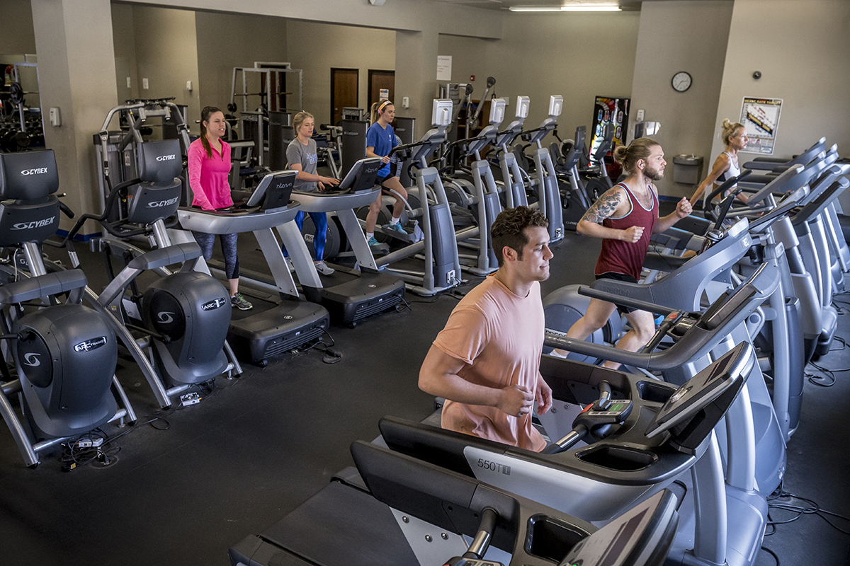 OCU Fitness Center - five students running on treadmills